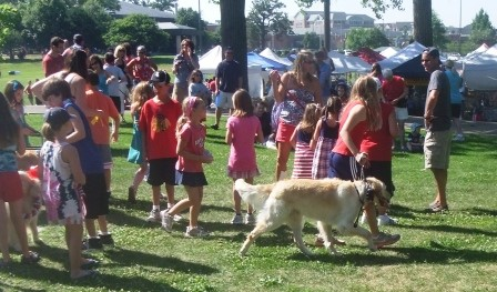 Large group of people with golden retriever