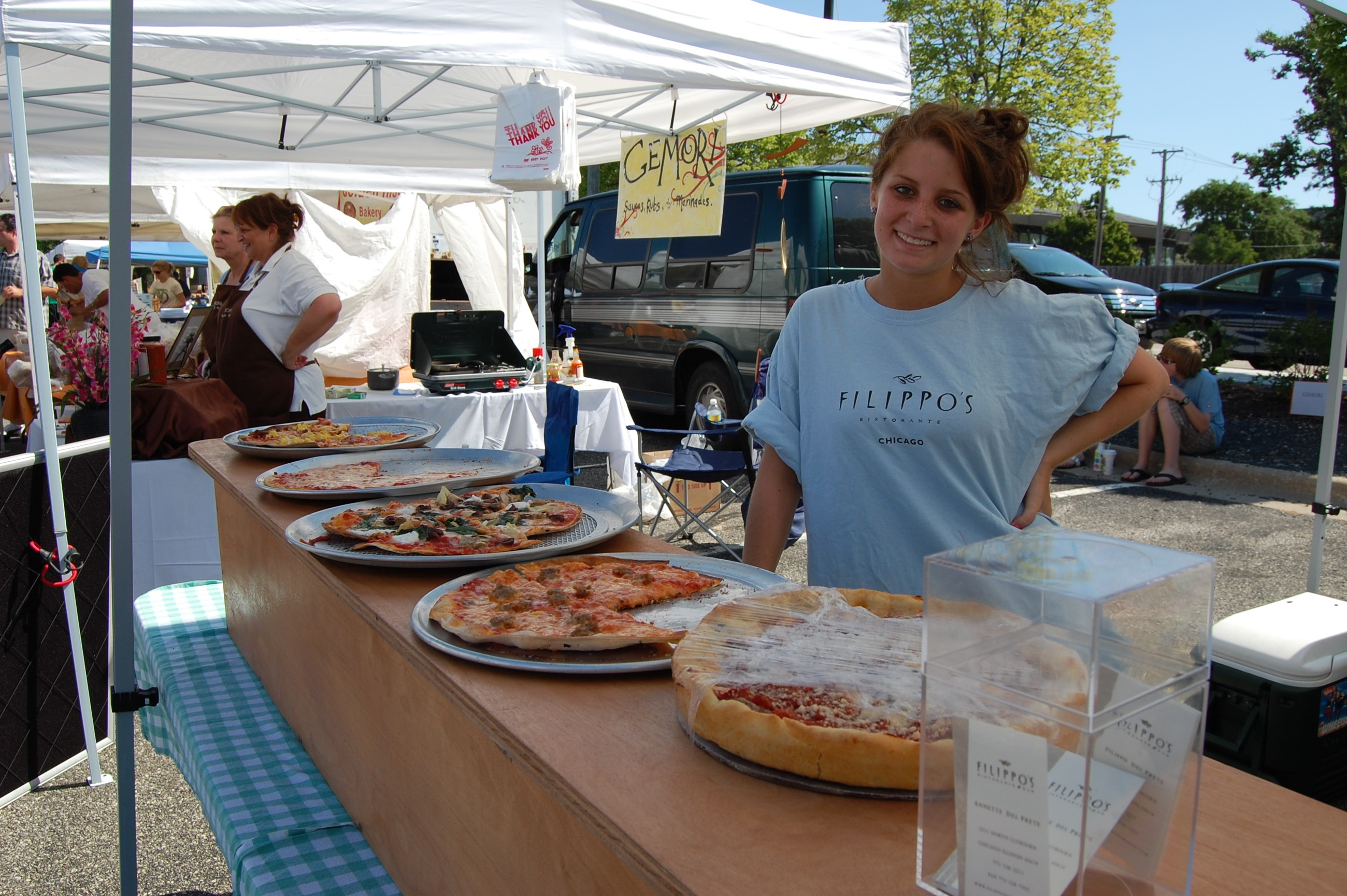 Vendor with multiple pizzas