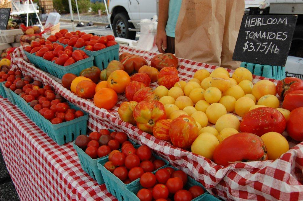 Orange, yellow and red produce for sale